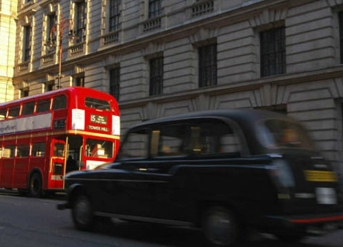 a red bus and a black taxi